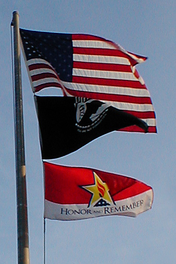 honor and remember with american flag and pow flag