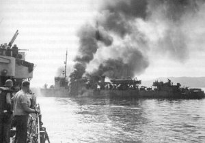 USS Ward burning