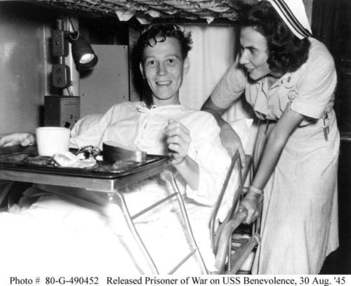 733px-Navy_nurse_and_released_POW_on_USS_benevolence,_August_1945_highres