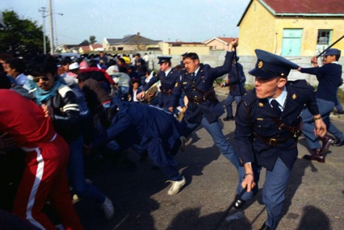 Police Officers Try to Control Protesters
