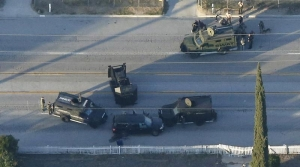 An SUV with its windows shot out that police suspect was the getaway vehicle from at the scene of a shooting in San Bernardino, California is shown in this aerial photo December 2, 2015. Gunmen opened fire on a holiday party on Wednesday at a social services agency in San Bernardino, California, killing 14 people and wounding 17 others, then fled the scene, triggering an intense manhunt and a shootoutout with police, authorities said. REUTERS/Mario Anzuoni TPX IMAGES OF THE DAY - RTX1WX2P