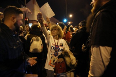 Donald Trump supporter Birgitt Peterson of Yorkville, Ill., argues with protesters outside the UIC Pavilion after the cancelled rally for the Republican presidential candidate in Chicago on Friday, March 11, 2016. (E. Jason Wambsgans/Chicago Tribune/TNS via Getty Images)