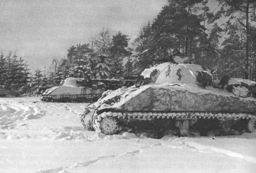 American_7th_Armored_Division_Shermans_taking_up_positions_outside_St._Vith,_1944